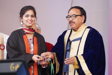 HRD Minister of State (Higher Education) Dr Mahendra Nath Pandey giving a Gold Medal to a graduating student at JMI's Annual Covocation-2016